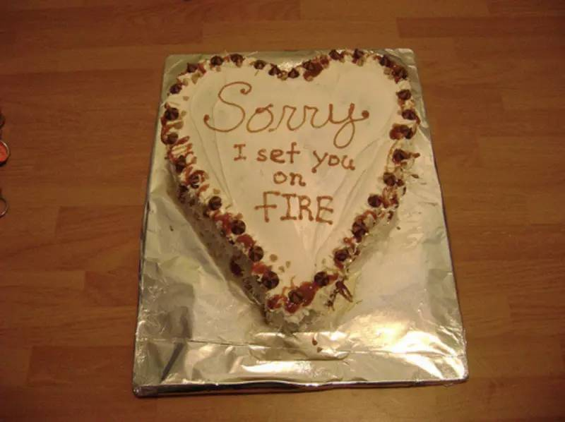 "Cake with ""Sorry I set you on fire"" Written on the front"