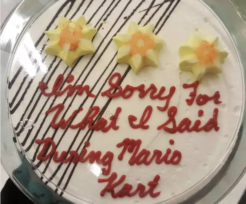 "Cake with ""I'm sorry for what I said during Mario Kart"" Written on the front"